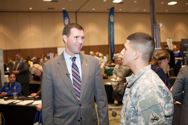 Hiring Our Heroes President Eric Eversole, left, interacts with job candidates at a career fair. (Provided by Hiring Our Heroes)
