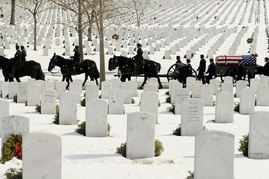 A caisson team from the Old Guard carries the remains of Army Sgt. Peter C. Bohler to Section 60 at Arlington National Cemetery on Jan. 23, 2014. Bohler died in a helicopter crash in Afghanistan on Dec. 17, 2013. (Mike Morones/Staff)