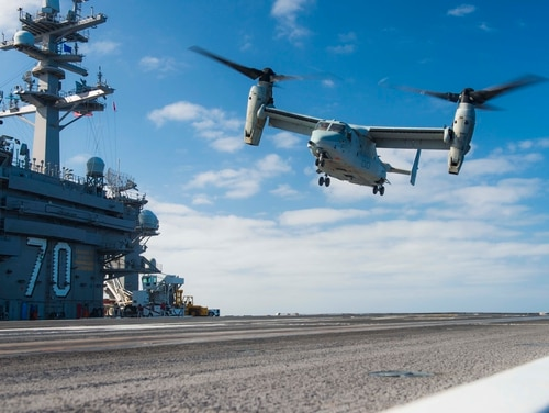 A MV-22B Osprey, from Marine Operational Test and Evaluation Squadron 1, lands on the flight deck of the aircraft carrier Carl Vinson. Not only did the Vinson host shipboard tests of the Osprey, it will host the new CMV-22B on its first operational deployment alongside the F-35C Joint Strike Fighter. (MC3 Matthew Brown/Navy)