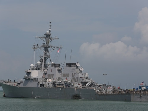 Guided-missile destroyer John S. McCain moored pier side at Changi Naval Base, Republic of Singapore following a collision with the merchant vessel Alnic MC while underway east of the Straits of Malacca and Singapore on Aug. 21. (Grady Fontana/Navy)