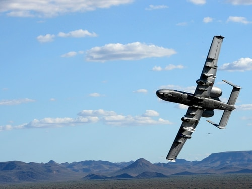 Tactical air control party members with the 147th Air Support Operations Squadron, 147th Reconnaissance Wing, control an A-10 Warthog from the 357th Fighter Squadron at Davis Monthan Air Force Base, Arizona, at the Barry M. Goldwater Air Force Range in Gila Bend, Arizona, April 12, 2016. The battlefield airmen traveled to the desert range in Gila Bend for a weeklong simulated deployment with their Czech partners. (U.S. Air National Guard photo by 1st Lt. Alicia Lacy/Released)