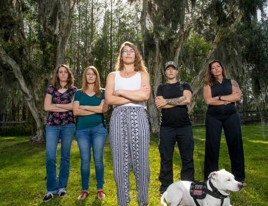 Christina Brenia, Jeannine Laurence, Mariah King, Sarah Thomas and Janel Norton pose for a portrait together on March 28, 2021. After King filed a report with New Port Richey Police alleging that Veterans Alternative Founder and CEO Brian Anderson touched her inappropriately, Brenia, Laurence and Thomas came forward with their own accusations against Anderson. (Ivy Ceballo/Tampa Bay Times)