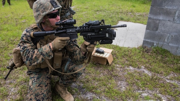 A Marine prepares to fire an M320 grenade launcher module mounted on an M4 rifle at simulated enemy targets at Camp Lejeune, North Carolina, June 6, 2017. (Lance Cpl. Taylor W. Cooper/Marine Corps)