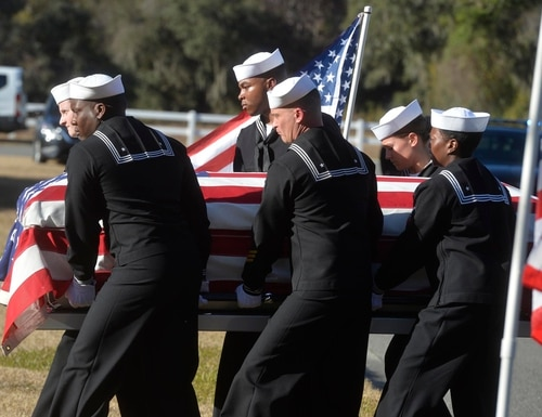 Sailors carry the casket of Airman Apprentice Cameron Walters at Oak Hill Cemetery in Richmond Hill, Ga., on Dec. 16, 2019. Walters was one of the three Navy sailors killed in a Saudi gunman's attack at Naval Air Station Pensacola, Florida, on Dec. 6, 2019. (Steve Bisson/Savannah Morning News via AP)