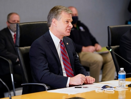 FBI Director Christopher Wray speaks during a briefing about the upcoming presidential inauguration of President-elect Joe Biden and Vice President-elect Kamala Harris, at FEMA headquarters, Thursday, Jan. 14, 2021, in Washington. (Alex Brandon/Pool via AP)