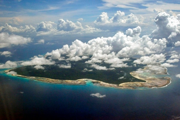In this Nov. 14, 2005 photo, clouds hang over the North Sentinel Island, in India's southeastern Andaman and Nicobar Islands. (Gautam Singh/AP)