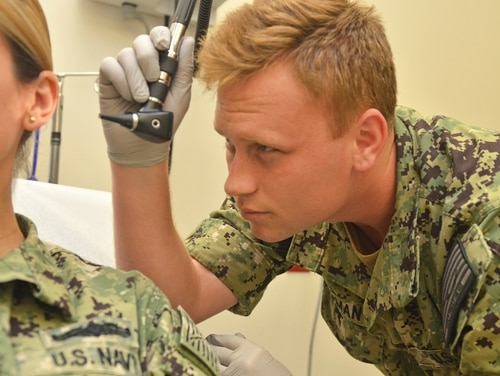 Under Defense Department plans to change the military health system, military personnel will continue to treat other military personnel while family members and other retirees will be seen mainly by civilian doctors, nurses and physician assistants. (Jacob Sippel/Navy)