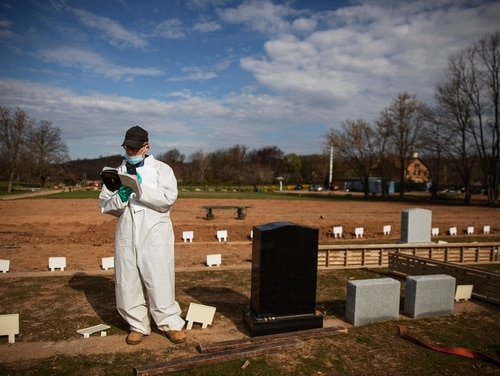 Rabbi Shmuel Plafker conducts a burial service for someone presumed to have died from coronavirus at the Hebrew Free Burial Association's cemetery in the Staten Island, N.Y., on April 7, 2020. (David Goldman/AP)