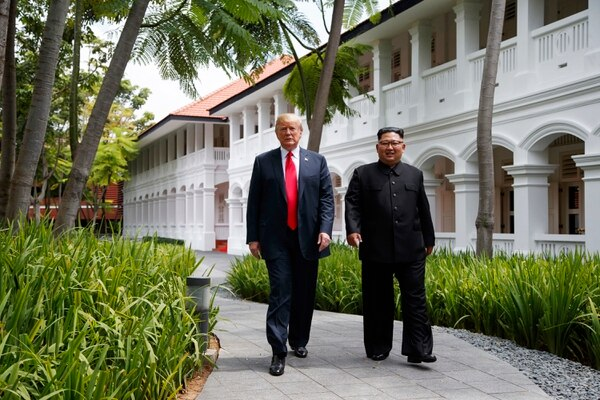 President Donald Trump walks with North Korean leader Kim Jong Un on Sentosa Island in Singapore on June 12, 2018. The North Korean leader has told the White House he'd like more face-to-face talks with the American president, but where that would take place remains unclear. (AP Photo/Evan Vucci, File)