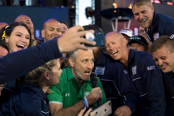 Movie and television personality Jon Stewart takes selfies with Team Navy during opening ceremonies for the 2018 Warrior Games at the Air Force Academy in Colorado Springs, Colo., June 2, 2018. (EJ Hersom/DoD)
