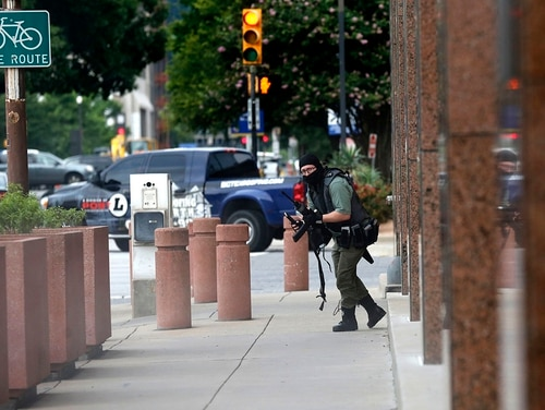 An armed shooter, later identified as Brian Isaack Clyde, stands near the Earle Cabell Federal Building Monday, June 17, 2019, in downtown Dallas. The shooter was hit and injured in an exchange of gunfire with federal officers outside the courthouse. (Tom Fox/The Dallas Morning News)
