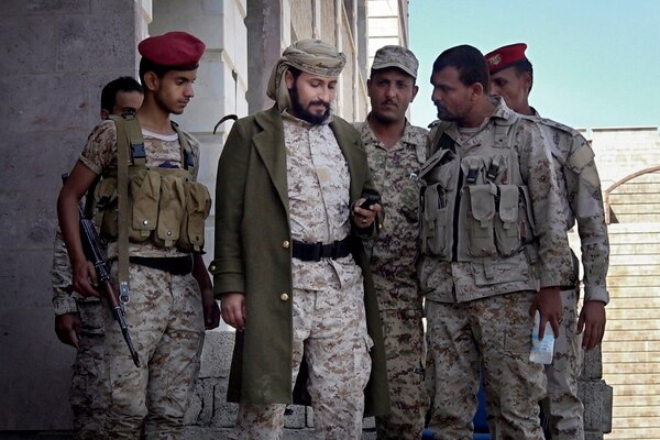Adnan Rouzek, center, a Salafi militia leader backed by Yemen's president, stands with fighters in Taiz, Yemen, in this Feb. 6, 2018, photo. (AP)
