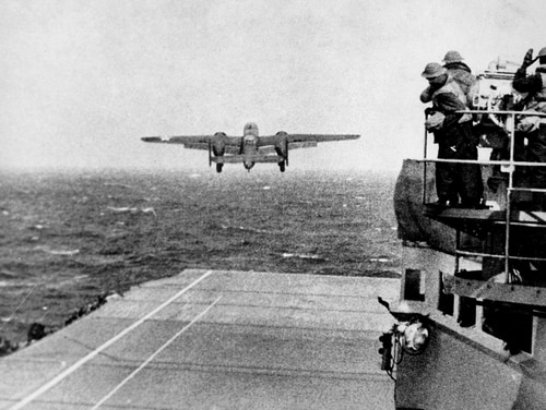 A USAAF B-25 bomber takes off from the deck of the aircraft carrier USS Hornet en route to Tokyo for bombing mission which became known as the