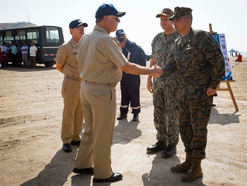Peruvian Navy Adm. Fernando Cerdan, commander in chief of the Peruvian Navy, shakes hands with Marine Corps Lt. Col. Francisco X. Zavala, commanding officer of Special Purpose Marine Air-Ground Task Force–Peru, before a press conference Nov. 11, 2018, near Lima, Peru. (Sgt. Marimar M. Morales/Marine Corps)