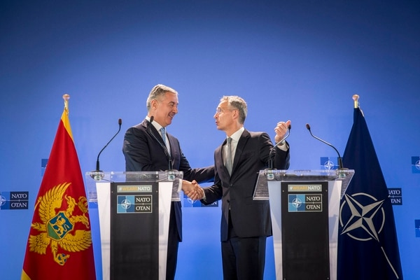 President Milo Đukanović of Montenegro, left, has moved to deepen security ties with NATO, including welcoming allied air patrols and pledging to meet defense spending goals. (NATO)
