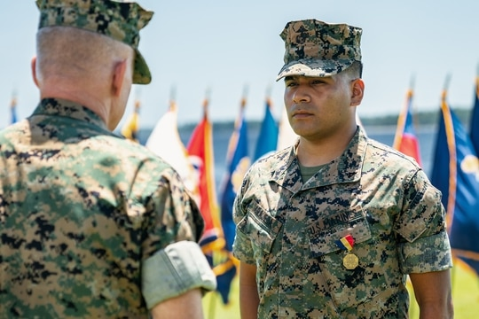 Marine Corps Lance Cpl. Kevin A. Grajeda, Combat Logistics Regiment 27, (CLR-27), 2nd Marine Logistics Group (2nd MLG), is awarded with the Navy and Marine Corps Medal by Col. Brian W. Mullery, commanding officer of CLR-27, 2nd MLG, at Camp Lejeune, North Carolina July 17, 2020. (Cpl. Rachel K. Young-Porter/Marine Corps)