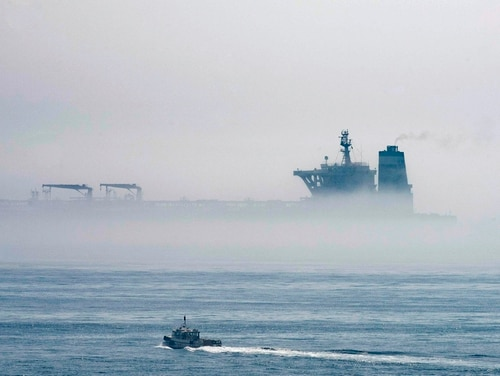 The Grace 1 supertanker is seen through the sea fog in the British territory of Gibraltar on Aug. 15. (Marcos Moreno/AP)