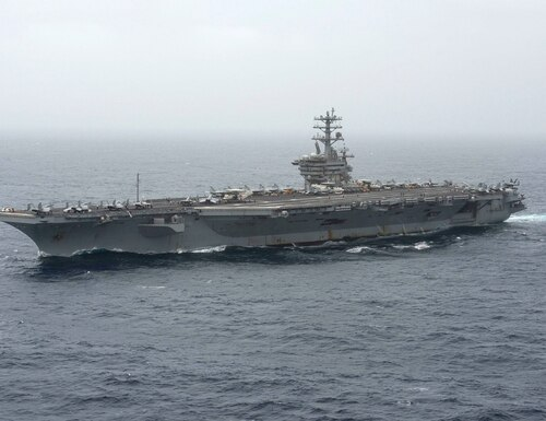 The aircraft carrier Nimitz transits the Arabian Sea Aug. 17. the Nimitz and the guided-missile cruiser Princeton are conducting search-and-rescue operations for a missing Nimitz sailor. (MC3 Elliot Schaudt/Navy)