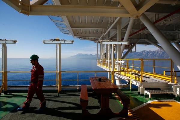 A worker walks on Turkey's new drillship 'Conquerer' off the coast of Antalya, southern Turkey. (Lefteris Pitarakis/AP)
