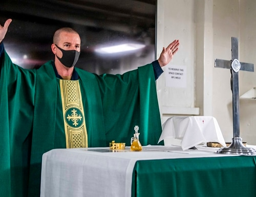 Lt. Cmdr. Jason Sluder, command chaplain aboard the USS Germantown, leads a worship service Sunday as the dock landing ship operates in the Philippine Sea. (MC2 Taylor DiMartino/Navy)
