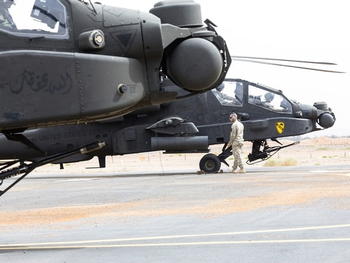 U.S. Army soldiers prepare their AH-64 Apache before a practice air assault during Exercise Friendship and Iron Hawk 14 on April 12, 2014, near Tabuk, Saudi Arabia. Iron Hawk and Friendship 14 involved U.S. Army forces and Saudi Arabian ground and aviation forces. (Sgt. Harley Jelis/Army National Guard)