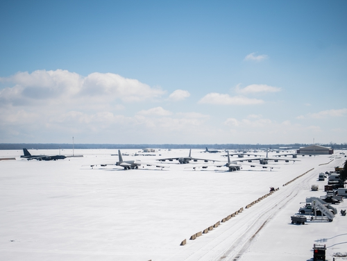 Snow covered B-52H Stratofortresses sit on the flightline at Barksdale Air Force Base, La., Feb. 19. Approximately four inches of snow fell on the base Feb. 14 and 15. An additional two inches of snow and sleet were recorded on Feb. 17. (Airman 1st Class Jacob Wrightsman/Air Force)