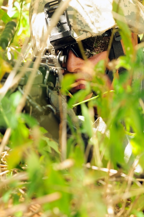 U.S. Army Sgt. Reynaldo Figueroa, with the 973rd Quartermaster Company, performs perimeter security during training at the Warrior Leader Course at Fort Allen's 201st Regional Training Institute in Juana Díaz, Puerto Rico, April 22, 2013. (U.S. Army National Guard photo by Staff Sgt. Joseph Rivera Rebolledo/Released)