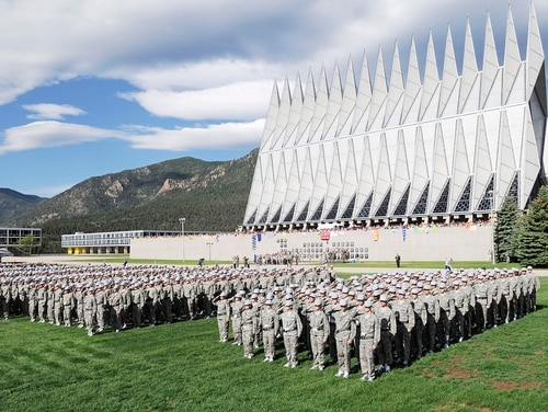 More than 1,300 basic cadets salute June 26 during their first reveille formation at the U.S. Air Force Academy in Colorado Springs, Colo. (Mike Kaplan/Air Force)