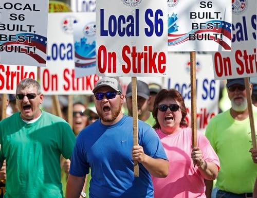 In this July 25, 2020 file photo, striking Bath Iron Works shipbuilders march in solidarity in Bath, Maine. (Robert F. Bukaty/AP)