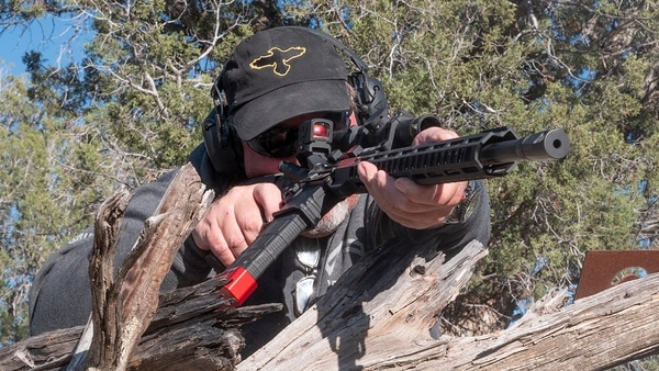 The ultimate shooting competition is 3 Gun, and wielding the rifle around obstacles is the name of the game. (Photo by David Bahde)