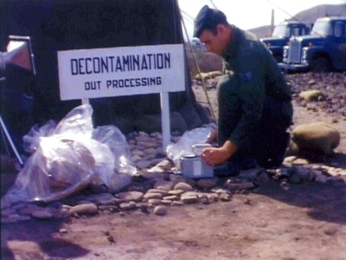 In this February 1966 photo from the National Archives, an unidentified U.S. soldier looks through the material found after a B-52 bomber crashed with a tanker plane during aerial refueling on Jan 17, 1966, causing several hydrogen bombs to fall and explode in south-eastern Spain. New legislation introduced this week would speed the VA benefits process for veterans of the clean-up work. (AP)