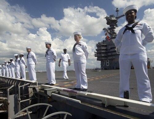 Sailors assigned to aircraft carrier Gerald R. Ford man the rails as they depart Naval Station Norfolk, Va., June 7. (MC1 Julie Matyascik/Navy)