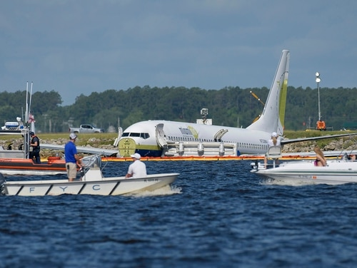 A charter plane carrying 143 people and traveling from Cuba to north Florida sits in a river at the end of a runway, Saturday, May 4, 2019 in Jacksonville, Fla. (Will Dickey/The Florida Times-Union via AP)