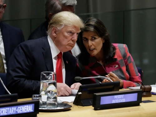 President Donald Trump speaks with the U.S. Ambassador to the U.N. Nikki Haley on Sept. 24, 2018, at the United Nations General Assembly in New York. (Evan Vucci/AP)