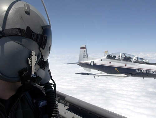 A T-6 Texan pilot flies in formation with another T-6 over Laughlin Air Force Base, Texas. The Air Force has cut the number of pilots it originally hoped to train this year. (Tech. Sgt. Jeffrey Allen/Air Force)