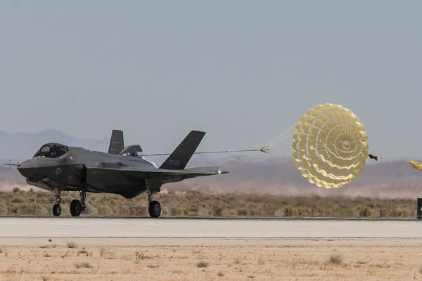 An F-35A jet, modified with a drag chute designed for Norwegian Air Force F-35As, deploys its chute upon test landing at Edwards Air Force Base, Calif. (Lockheed Martin)