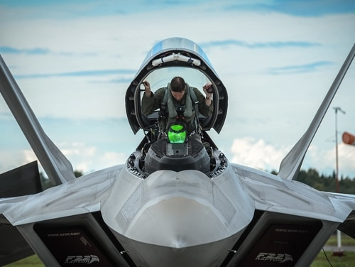 An F-22 pilot from the 95th Fighter Squadron based out of Tyndall Air Force Base, Fla., gets situated in his aircraft prior to taking from Ämari Air Base, Estonia, Sept. 4, 2015, during a brief forward deployment. The Air Force is rolling out a series of incentives and new policies it hopes will convince pilots to stay in uniform. (Tech. Sgt. Ryan Crane/Air Force)