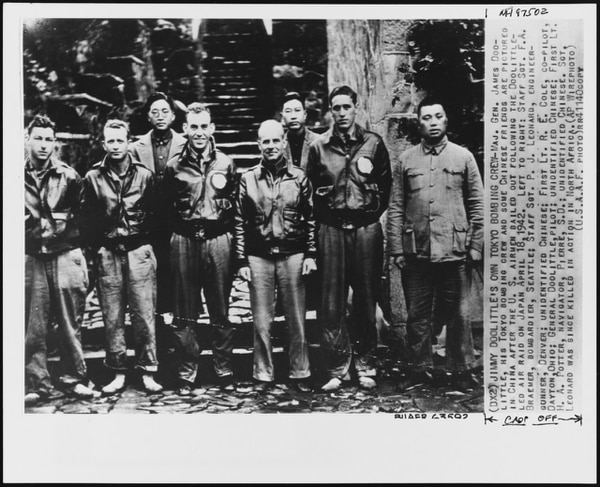 Lt. Col. James H. Doolittle (center) with members of his flight crew and Chinese officials in China after the 18 April 1942 attack on Japan. (U.S. Naval History and Heritage Command)
