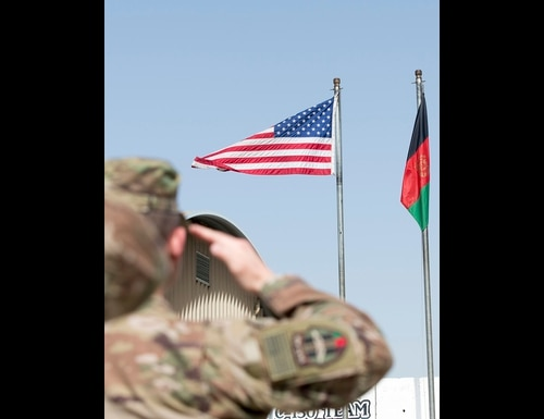 Airmen with the 438th Air Expeditionary Advisory Group salute the flag during the start of an assumption of command ceremony June 5, 2018, Kabul, Afghanistan. (Staff Sgt. Jared J. Duhon/Air Force)
