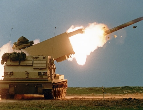 MLRS fires a Guided Multiple Launch Rocket System rocket. (Army)