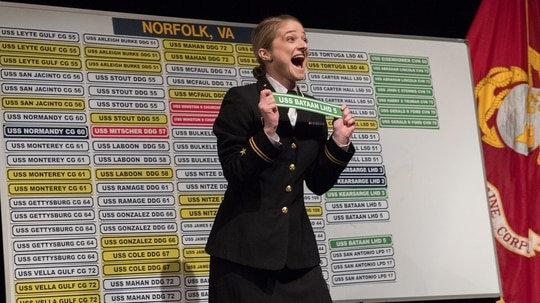 Midshipman 1st Class Kylie Johnson, 22nd company, celebrates after choosing the Wasp-class amphibious assault ship USS Bataan (LHD 5) as her first duty assignment on Jan. 31, 2019. Two hundred fifty-nine future surface warfare officers selected their first duty assignments during the U.S. Naval Academy's ship selection in Alumni Hall. (Kenneth D. Aston Jr./Navy)