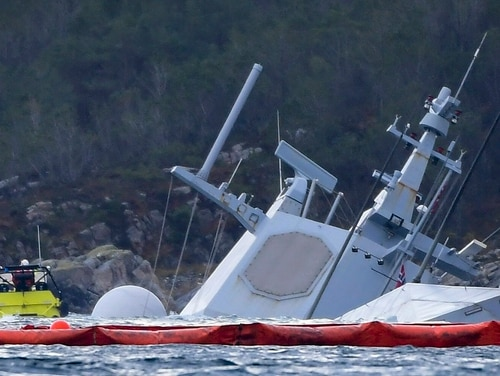 The Norwegian frigate KNM Helge Ingstad is seen partly underwater in the sea near Bergen, western Norway, on Nov. 13, 2018. A new report from Norwegian investigators raises questions about the design of the ship.(Marti Hommedal/AFP via Getty Images)