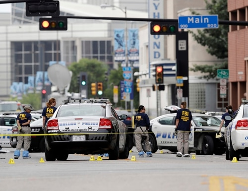 Investigators work in the area of downtown Dallas that remains an active crime scene, Saturday, July 9, 2016. Micah Johnson, an Army veteran, opened fire on police officers in the heart of Dallas Thursday, as hundreds of people were gathered to protest two recent fatal police shootings of black men, Philando Castile and Alton Sterling.(AP Photo/Eric Gay)