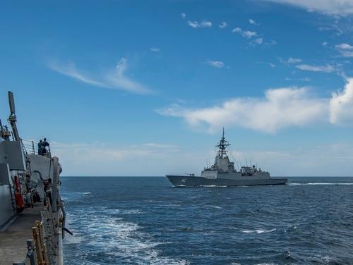 The Arleigh Burke-class guided-missile destroyer USS John Finn (DDG 113), left, transits the Pacific with the Royal Australian Navy Hobart-class destroyer HMAS Sydney (DDG 42) April 1, 2021. (MC3 Jason Waite/Navy)