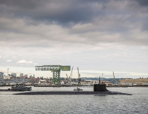 The Seawolf-class fast attack submarine Connecticut departs Puget Sound Naval Shipyard for sea trials following a maintenance availability in late 2016. The base that sprawls across large portions of Kitsap County is tracking 14 potential coronavirus cases in its workforce. (Thiep Van Nguyen II/Navy)