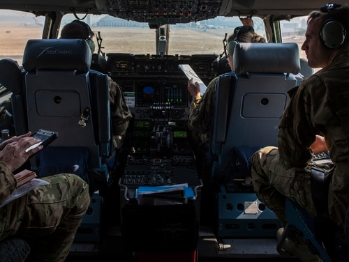 An Air Force crew with the 16th Airlift Squadron, Joint Base Charleston, South Carolina, wait to taxi on a C-17 Globemaster III aircraft prior to take off during Mobility Guardian at Joint Base Lewis- McChord, Washington, on Aug. 2. (Tech. Sgt. Gregory Brook/Air Force)