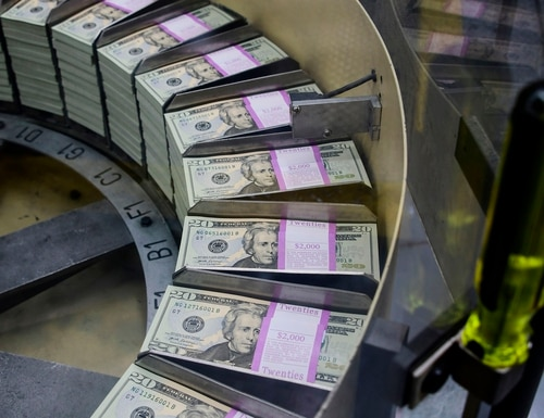 Packs of freshly printed $20 bills are processed for bundling and packaging at the U.S. Treasury's Bureau of Engraving and Printing in Washington on July 20, 2018. (Eva Hambach/AFP via Getty Images)