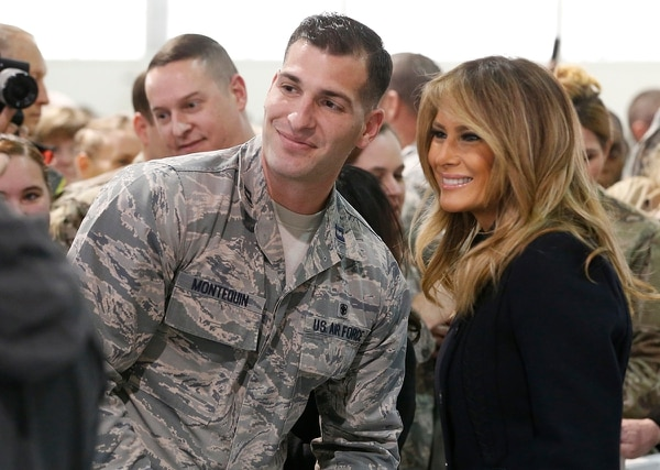 First lady Melania Trump, right, poses with an airman during a tour of Joint Base Langley-Eustis in Hampton, Va., Wednesday, Dec. 12, 2018. (Steve Helber/AP)