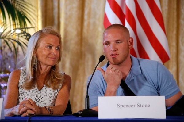 U.S. Airman Spencer Stone, right, seated next to U.S. Ambassador to France Jane D. Hartley, answers questions during a press conference held at the U.S. Ambassador's residence in Paris, France, Sunday, Aug. 23, 2015. Stone and two friends, Antony Sadler and Alek Skarlatos, helped foil a potentially deadly attack when they subdued a man armed with an assault rifle and other weapons on board a high-speed train bound for Paris two days ago. The man was known to intelligence services in three countries and had ties to radical Islam, authorities said Sunday. (AP Photo/Francois Mori)