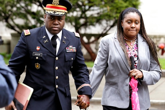 In this May 9, 2013, file photo, John Jackson, left, and his wife Carolyn Jackson, of Mount Holly, N.J., walk out of Martin Luther King, Jr. Courthouse in Newark, N.J. (Julio Cortez/AP)